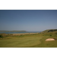 The par-5 16th hole plays along the coastline at St. Enodoc Golf Club.