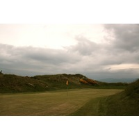 Porthmadog Golf Club's 15th green is surrounded by dunes on each side.