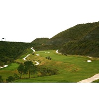 The par-5 16th hole's fairway at Gran Flamingo is ultra-tight, running along a mountainside.