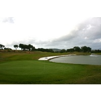 No. 9 on San Roque Club's New Course wraps around a large pond.