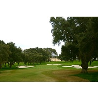 No. 18 at Valderrama Golf Club is a long, challenging, finishing par 4, dog-legging left to a raised green.