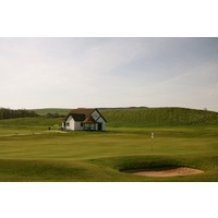 A tiny pro shop sits next to the first tee and fourth green at Dunbar Golf Club.