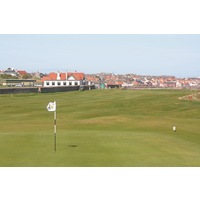 An old stone wall separates the coastal holes from the four inland holes at Dunbar Golf Club.