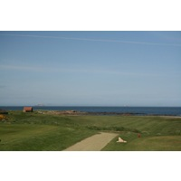 Dunbar Golf Club's 14th hole is a downhill dogleg left defended by water on the right.