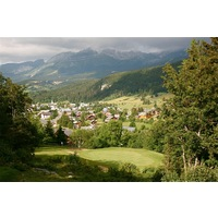 The 18th hole at Correncon en Vercors Golf Club is a downhill par 3 with views of the village as a backdrop.