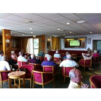 Members of Pyle & Kenfig Golf Club watch the closing moments of the 2010 Ryder Cup.