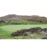 The first green at the Island Golf Club introduces the dunes.