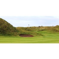 The Island Golf Club's sixth green is tucked into dunes.