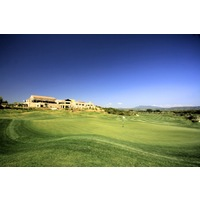 The Dunes Course at Costa Navarino features a large clubhouse with a restaurant overlooking the layout.