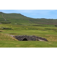 A burn guards the 16th green at Dingle Golf Links.