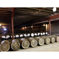 Whisky barrels line the floor at the Tomatin distillery in the Highlands.