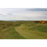 The third hole at Murcar Links Golf Club is a semi-blind par 4 to a green nestled in the dunes.