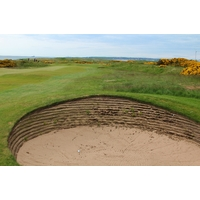 Pot bunkers such as this one along the first fairway defend Murcar Links Golf Club.