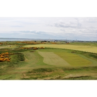 The 13th hole at Murcar Links Golf Club drops dramatically off a ridge to the green.