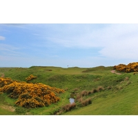 The par-3 16th hole of Murcar Links Golf Club plays significantly uphill over a stream.