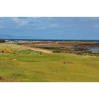The view from the ridge above the eighth green on the Championship Course at Royal Dornoch Golf Club reveals the beach along the Dornoch Firth.