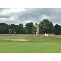 The third green on the White Course at Barriere Golf Deauville sits near a ruin of a castle wall.