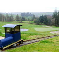 A tiny funicular transports golfers between the third green and fourth tee at Lisselan.