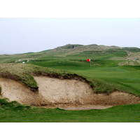 A deep bunker guards the 17th green on the Old Course at Lahinch, one of the lowest points on the golf course.
