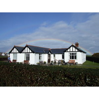 Ever-changing weather makes rainbows like this one over Royal County Down's Annelsley Links clubhouse a frequent sight in Ireland.